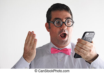 Surprised Geeky man receives a surprising message or phone call