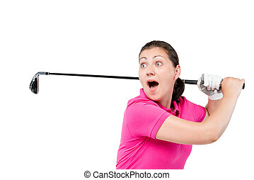 Surprised girl golfer is looking at the ball and is happy on a white background