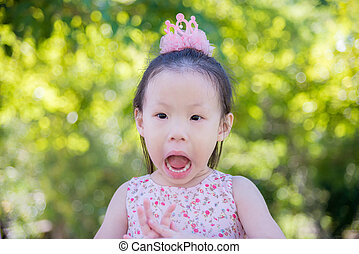 surprised girl in park