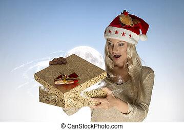 surprised girl opening christmas box