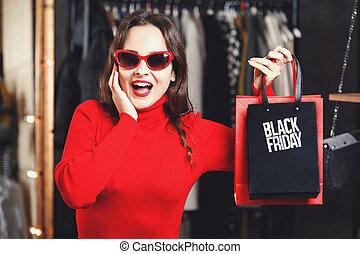 Surprised Girl Showing Black Friday Bag