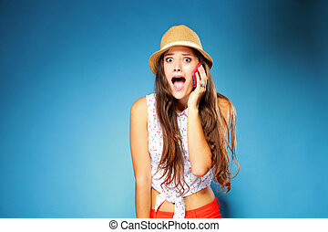 surprised girl talking on mobile phone