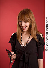 Surprised girl with mobile phone
