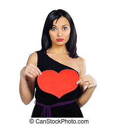 Surprised girl with red Valentine heart isolated on white