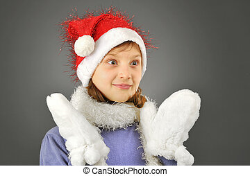 surprised girl with santa hat