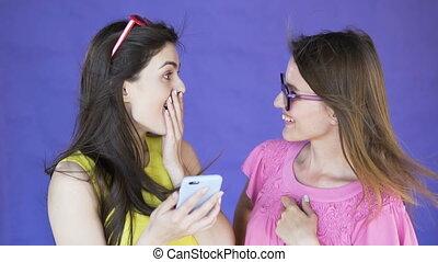 Surprised Girls Look at Selfie