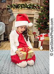 Surprised kid looking at gift box