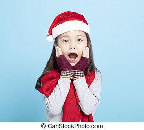 surprised little girl in Santa hat