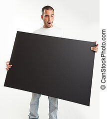 Surprised Man holding blackboard