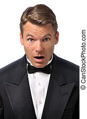 Surprised man in tuxedo