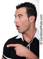 surprised man pointing at something