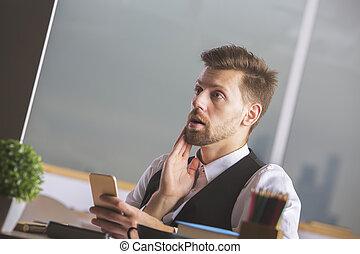 Surprised man using smartphone