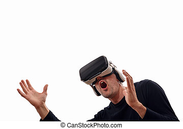 Surprised man with black pullover and virtual reality glasses with open hands looking up. Horizontal composition. Isolated white