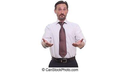 Surprised or shocked businessman in studio
