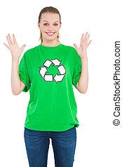 Surprised pretty environmental activist raising her hands
