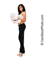 Surprised pretty girl with a teddybear