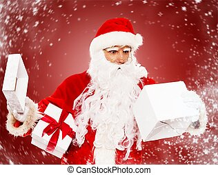 Surprised Santa Claus with opened gift box