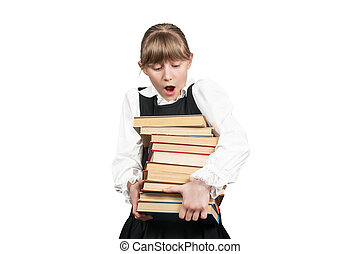 Surprised schoolgirl with a stack of books