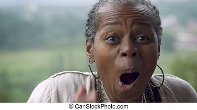 Surprised senior woman in 60s expressing she won something -...