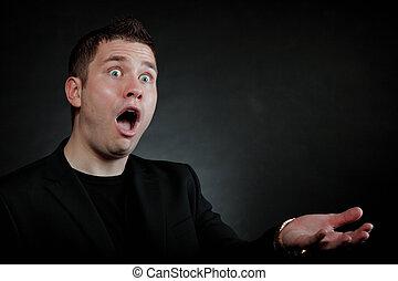 surprised shocked man wide eyed face