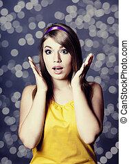 Surprised teen girl.