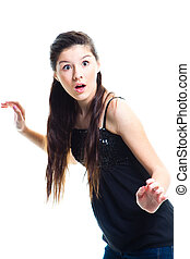 surprised  teenager girl with long dark hair on isolated white