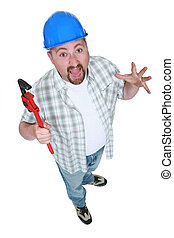 Surprised tradesman holding a pipe wrench