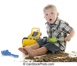 Surprised when Playing with Sand - An adorable preschooler ...