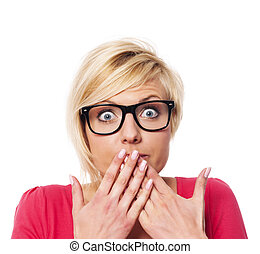 Surprised woman covering with hands her mouth