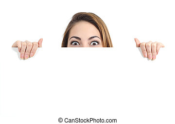 Surprised woman eyes over a blank promotional display...