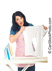 Surprised woman holding burned shirt
