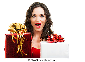 Surprised woman holding Christmas presents