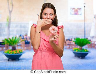 Surprised Woman Holding Doughnut