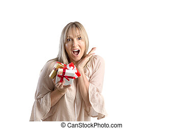 Surprised woman holding wrapped gifts on white background