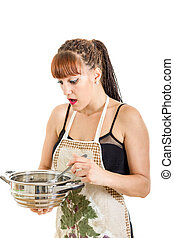Surprised woman in the kitchen stirring the pot