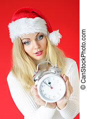 Surprised woman looking at clock