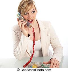 Surprised woman on a landline telephone