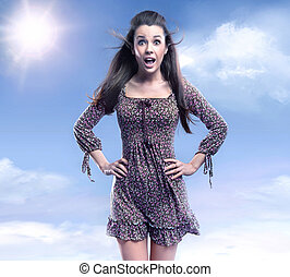 Surprised woman on the beauty sky background