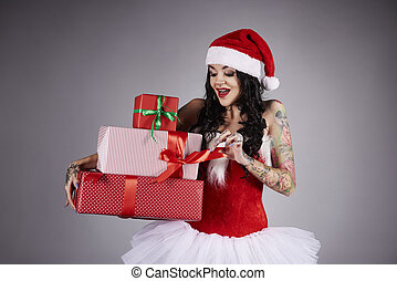 Surprised woman opening a christmas present