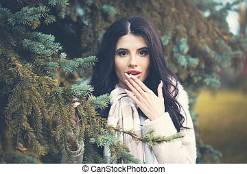 Surprised woman outdoors. Beautiful fashion girl portrait
