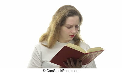 Surprised woman reading book