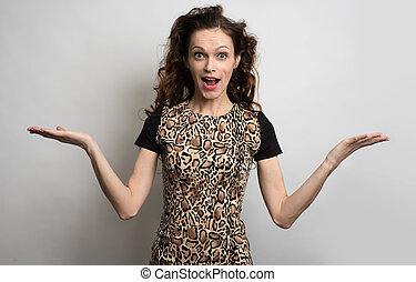surprised woman with beauty long curly hair