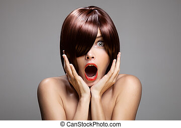Surprised woman with perfect long glossy brown hair. Close-...