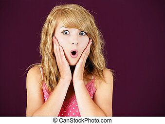 Surprised young blond woman