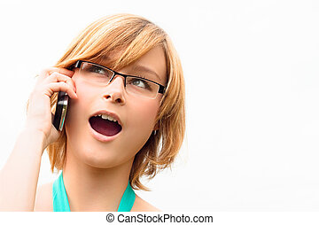 Surprised young business woman on phone