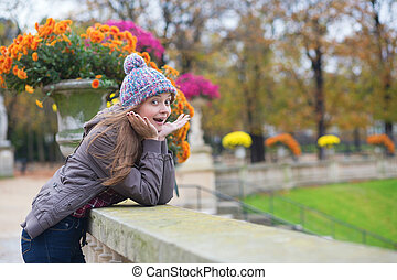 Surprised young girl in park