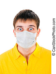 Young Man in Flu Mask - Surprised Young Man in Flu Mask on...