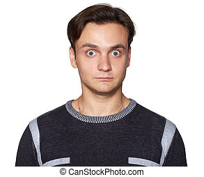 surprised young man looking at camera. Isolated