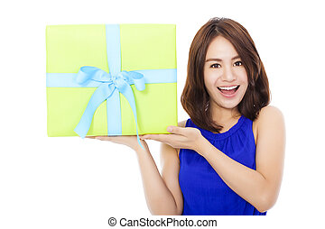 surprised young woman holding a gift box