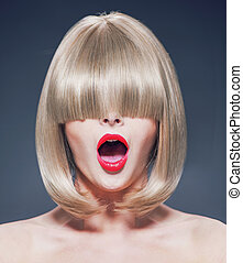 Surprised young woman with a long fringe